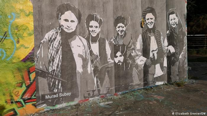 Black-and-white street art showing different world leaders as Taliban