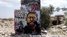 IDLIB, SYRIA - JUNE 02: A 36-year old graffiti artist Aziz Asmar paints a mural depicting of George Floyd, an unarmed black man who died after being pinned down by a white police officer in Minneapolis, on a wall of house ruins in Binnish district in Idlib province, Syria on June 02, 2020. Izzeddin Idilbi / Anadolu Agency