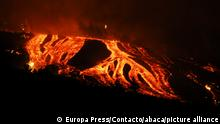 Rivers of lava and pyroclasts in the Cabeza de Vaca area, on September 19, 2021, in El Paso, La Palma, Santa Cruz de Tenerife, Canary Islands, (Spain). The volcanic eruption that began yesterday at 4 p.m. in the Cabeza de Vaca area (La Palma), just when the seismic activity on the island of La Palma had reached the maximum since the beginning of the swarm a week ago, is in these moments with two fissures, about 200 meters apart, and eight mouths through which the lava emerges. At least 15 homes are affected by the eruption early this Monday and there are already more than 5,000 evacuated at the moment. Experts do not know when this eruption will end, which has left temperatures of 1,075 ° C in the rivers of lava coming from the volcano. Photo by Europa Press/Europa Press/ContactPhoto/ABACAPRESS.COM