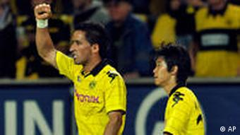 Dortmund's Lucas Ramon Barrios and Shinji Kagawa celebrate after scoring the second goal during the UEFA Europa League playoff soccer match against FK Qarabagh in Dortmund on Thursday, August 19, 2010.
