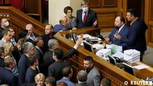 Opposition lawmakers argue with the first deputy parliament speaker Ruslan Stefanchuk during a parliament session to vote for a law that order oligarchs to register and stay out of politics