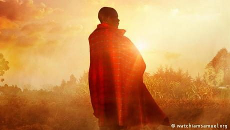 A still from the film 'I am Samuel' showing a man wrapped in a blanket with the sun shining behind him
