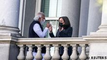 U.S. Vice President Kamala Harris talks with India's Prime Minister Narendra Modi on the balcony of the Eisenhower Executive Office Building at the White House complex in Washington, U.S., September 23, 2021. REUTERS/Evelyn Hockstein