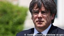 Exiled former Catalan leader and member of European Parliament Carles Puigdemont (R) speak during a press conference with newly appointed Catalan regional president Pere Aragones at Casa de la Republica in Waterloo on June 18, 2021. (Photo by Kenzo TRIBOUILLARD / AFP) (Photo by KENZO TRIBOUILLARD/AFP via Getty Images)