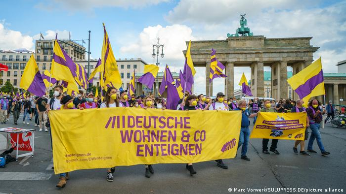 Activists from the Expropriate Deutsche Wohnen and co. campaign in front of the Brandenburg Tor in Berlin