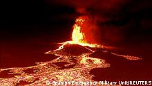 22/09/2021*** Screen grab from a video taken by a night drone shows a volcano erupting and tongues of lava in La Palma, Spain September 22, 2021. Spanish Emergency Military Unit (UME)/Reuters TV/Handout via REUTERS THIS IMAGE HAS BEEN SUPPLIED BY A THIRD PARTY.