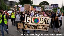 Activists hold banners during a protest march as part of the Fridays for Future climate movement's initiatives, in New Delhi, India, Friday, Sept. 24, 2021. Young people in India are demanding urgent action to halt catastrophic climate change and to slow global warming. Climate protesters in multiple Indian cities on Friday raised domestic environmental issues and called on politicians and big businesses to commit to a raft of climate pledges. (AP Photo/Manish Swarup)