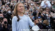 Swedish climate activist Greta Thunberg arrives at stage during a Fridays for Future global climate strike in Berlin, Germany, Friday, Sept. 24, 2021. (AP Photo/Markus Schreiber)