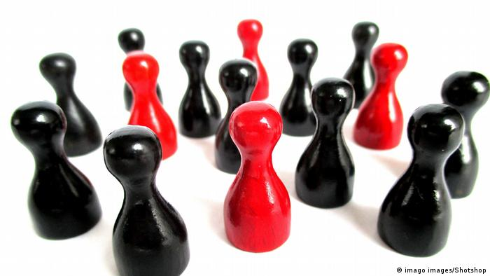 Red and black board game figures