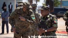 TOPSHOT - Mozambican President Filipe Nyusi (R) and Rwanda President Paul Kagame, both wearing military fatigue, are seen on 24 september 2021 in Pemba, Cabo Delgado province, Mozambique, during a visit to the Rwandan and Mozambican soldiers deployed there. - Close to 1,000 members of the Rwanda Defence Forces and Rwanda National Police are in the country working with the Mozambican Armed Defence Forces (FADM) and forces from the Southern African Development Community (SADC). The Rwandan joint forces are deployed in Cabo Delgado Province in northeastern Mozambique, where in collaboration with Mozambican Armed Defence Forces (FADM), they succeeded in liberating several key towns from terrorist groups. The towns liberated include the terrorist former stronghold of Mocimboa de Praia among others. (Photo by Simon WOHLFAHRT / AFP) (Photo by SIMON WOHLFAHRT/AFP via Getty Images)