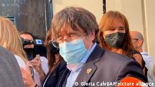Catalan leader Carles Puigdemont, leaves the jail of Sassari, in Sardinia, Italy, Friday, Sept. 24, 2021. Puigdemont, sought by Spain for a failed 2017 secession bid, on Friday was released following a court hearing, ahead of an Italian court decision on Spain's extradition request, a day after Italian police detained him in Sardinia, an Italian island with strong Catalan cultural roots and its own independence movement. (AP Photo/Gloria Calvi)