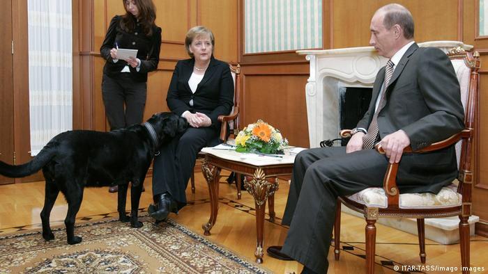 Angela Merkel with Vladimir Putin and his dog