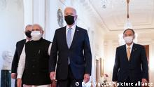 President Joe Biden walks to the Quad summit with from left, Australian Prime Minister Scott Morrison, Indian Prime Minister Narendra Modi, and Japanese Prime Minister Yoshihide Suga, in the East Room of the White House, Friday, Sept. 24, 2021, in Washington. (AP Photo/Evan Vucci)