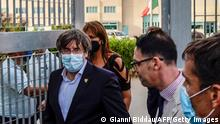Exiled former Catalan president Carles Puigdemont leaves after being released from jail on September 24, 2021 in Sassari, Sardinia island, Italy. - Exiled former Catalan president Carles Puigdemont, who was arrested in Sardinia on September 23, 2021 at Spain's request, was free to leave the country and his lawyer said Puigdemont would attend the next hearing in his extradition fight, on October 4, 2021. (Photo by Gianni BIDDAU / AFP) (Photo by GIANNI BIDDAU/AFP via Getty Images)