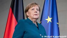 German Chancellor Angela Merkel arrives to make a press statement on the spread of the new coronavirus COVID-19 at the Chancellery, in Berlin on March 22, 2020. - German Chancellor Angela Merkel is going in to quarantine after meeting virus-infected doctor according to her spokesman on March 22, 2020. (Photo by Michael Kappeler / POOL / AFP)