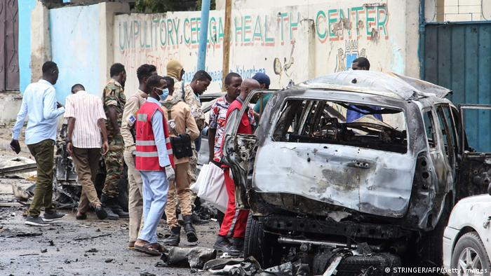 Security officers patrol on the site of a car-bomb attack in Mogadishu