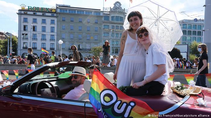 Two people campaign for marriage equality in Switzerland by dressing up in wedding attire