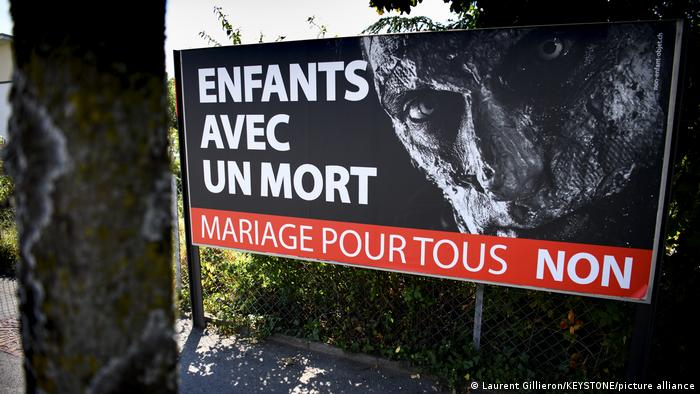 A billboard shows a zombie and reads in French 'Children with a dead person: No to marriage for all'