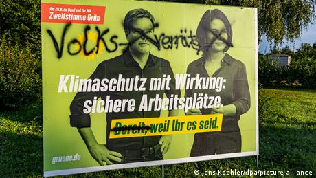 Graffiti on an election poster accusing the Green party's leaders of treason