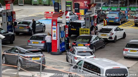 Large queues form on the second day of the fuel crisis at a petrol station on the A3 near Kingston, south-west London today as desperate motorists stop to fill up