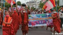 Ppro-democracy Buddhist monks and other supporters take part in a demonstration against the junta in Mandalay on September 25, 2021, marking the 14-year anniversary of the 2007 Saffron revolution. (Photo by STR / AFP)