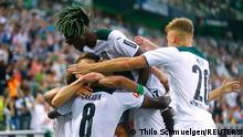 Soccer Football - Bundesliga - Borussia Moenchengladbach v Borussia Dortmund - Borussia-Park, Moenchengladbach, Germany - September 25, 2021 Borussia Moenchengladbach's Denis Zakaria celebrates scoring their first goal with teammates REUTERS/Thilo Schmuelgen DFL regulations prohibit any use of photographs as image sequences and/or quasi-video.