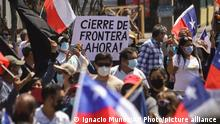 Residents take part in a march against illegal migration, in Iquique, Chile, Saturday, Sept. 25, 2021. Most of the migrants entering the country illegally are Venezuelans who enter from the north. (AP Photo/Ignacio Munoz)