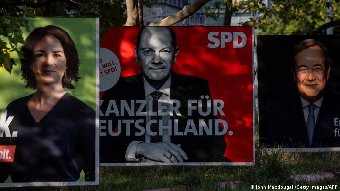 Cartazes dos três principais candidatos: Annalena, Scholz e Laschet