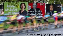 25/09/2021*** Skaters taking part in the In-line Skating event of the Berlin Marathon speed past election campaign posters showing the three chancellor candidates in the September 26 federal election, (L-R) co-leader of Germany's Greens (Die Gruenen) Annalena Baerbock, German Finance Minister and Vice-Chancellor of the Social Democratic SPD Party Olaf Scholz and Christian Democratic Union CDU leader Armin Laschet are seen in Berlin on September 25, 2021. (Photo by John MACDOUGALL / AFP) (Photo by JOHN MACDOUGALL/AFP via Getty Images)