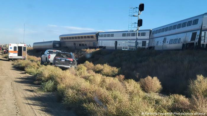 An ambulance is parked at the scene of an Amtrak train derailment