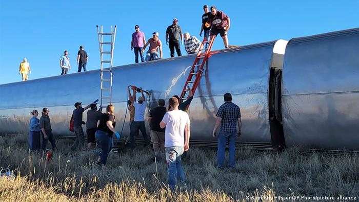 People work at the scene of an Amtrak train derailment