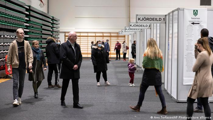 People vote at a local sports complex in Kopavogur, Iceland