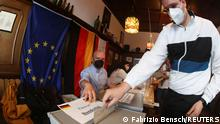 A man casts his vote for the general elections, in Berlin, Germany, September 26, 2021. REUTERS/Fabrizio Bensch
