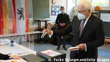 BERLIN, GERMANY - SEPTEMBER 26: German President Frank-Walter Steinmeier casts his vote for the general election, at a polling station on September 26, 2021 in Berlin, Germany. About 60 million people are eligible to vote in the German elections for a new federal parliament, the 20th Bundestag. (Photo by Focke Strangmann - Pool/Getty Images)