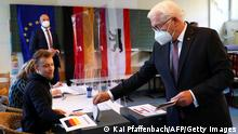 German President Frank-Walter Steinmeier casts his ballot at a polling station in Berlin, Germany, during general elections on September 26, 2021. (Photo by KAI PFAFFENBACH / POOL / AFP) (Photo by KAI PFAFFENBACH/POOL/AFP via Getty Images)