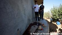 People check the scene where three Palestinians were killed by Israeli forces during a raid, in Beit Anan in the Israeli-occupied West Bank September 26, 2021. REUTERS/Mohamad Torokman