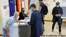 BERLIN, GERMANY - SEPTEMBER 26: Voters cast their ballots in the federal parliamentary elections on September 26, 2021 in Berlin, Germany. Voters are going to the polls nationwide today in elections that herald the end of the 16-year chancellorship of Angela Merkel and the strong possibility of a new, German Social Democrats (SPD) led coalition government. (Photo by Carsten Koall/Getty Images)