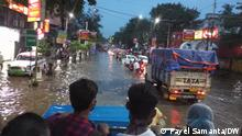 Dumdum near Kolkata is waterlogged for few days due to torrential rain. Local people are travelling in goods carriage as public transport is not available. Place: Kolkata Copyright: Payel Samanta