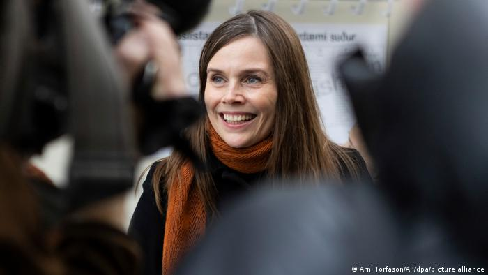 Iceland's Prime Minister Katrin Jakobsdottir speaks to reporters after casting her vote in the country's general election on Saturday