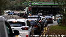 Motorists queue for petrol and diesel fuel at a petrol station off of the M3 motorway near Fleet, west of London on September 26, 2021. - Britain's transport secretary Grant Shapps on Sunday accused lorry industry representatives of helping to spark petrol panic-buying, as he defended a U-turn on post-Brexit immigration policy to ease an escalating supply crisis. (Photo by Adrian DENNIS / AFP) (Photo by ADRIAN DENNIS/AFP via Getty Images)