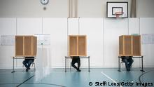 BERLIN, GERMANY - SEPTEMBER 26: Voters cast their ballots in federal parliamentary elections on September 26, 2021 in Berlin, Germany. Voters are going to the polls nationwide today in elections that herald the end of the 16-year chancellorship of Angela Merkel and the strong possibility of a new, German Social Democrats (SPD) led coalition government. (Photo by Steffi Loos/Getty Images)
