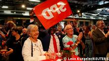 Supporters of the Social Democratic Party (SPD) react after first exit polls for the state elections in Berlin, Germany, September 26, 2021. REUTERS/Leon Kuegeler
