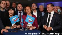 Deputy leader of the parliamentary group of the far-right Alternative for Germany (AfD) party Beatrix von Storch (C) and co-leader and top candidate of Germany's far-right Alternative for Germany (AfD) party Tino Chrupalla (R) react to exit pools at the event location La Festa during the electoral evening in an eastern district of Berlin on September 26, 2021 during the German general elections. (Photo by Ronny HARTMANN / AFP) (Photo by RONNY HARTMANN/AFP via Getty Images)