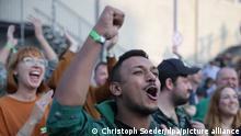 Green party supporters cheering