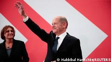Social Democratic Party (SPD) leader and top candidate for chancellor Olaf Scholz and his wife Britta Ernst react after first exit polls for the general elections in Berlin, Germany, September 26, 2021. REUTERS/Hannibal Hanschke