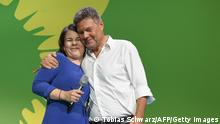 Co-leader of Germany's Greens (Die Gruenen) and the party's candidate for chancellor Annalena Baerbock (L) and co-leader of Germany's The Greens (Die Gruenen) party Robert Habeck react on stage during the Greens (Die Gruenen) electoral party after estimates were broadcast on television, in Berlin on September 26, 2021 after the German general elections. (Photo by Tobias SCHWARZ / AFP) (Photo by TOBIAS SCHWARZ/AFP via Getty Images)