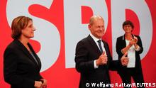 Social Democratic Party (SPD) leader and top candidate for chancellor Olaf Scholz, his wife Britta Ernst and party co-leader Saskia Esken react after first exit polls for the general elections in Berlin, Germany, September 26, 2021. REUTERS/Wolfgang Rattay