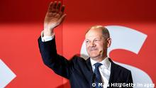 BERLIN, GERMANY - SEPTEMBER 26: Olaf Scholz, chancellor candidate of the German Social Democrats (SPD), waves to supporters in reaction to initial results at SPD headquarters in federal parliamentary elections on September 26, 2021 in Berlin, Germany. Voters have gone to the polls nationwide today in elections that herald the end of the 16-year chancellorship of Angela Merkel. (Photo by Maja Hitij/Getty Images)