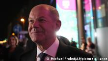 Olaf Scholz, Finance Minister and SPD candidate for Chancellor, leaves after attending a TV broadcast on the parliamentary elections in Berlin, Sunday, Sept. 26, 2021. Exit polls show the center-left Social Democrats in a very close race with outgoing Chancellor Angela Merkel's bloc in Germany's parliamentary election, which will determine who succeeds the longtime leader after 16 years in power. (AP Photo/Michael Probst)