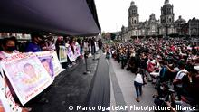 The relatives of 43 missing university students show placards with the names and photos of their missing loved ones, the seventh anniversary of the student's disappearance, in Mexico City's main square, The Zocalo, Sunday, Sept. 26, 2021. Relatives continue to demand justice for the Ayotzinapa students who were allegedly taken from the buses by the local police and handed over to a gang of drug traffickers. (AP Photo/Marco Ugarte)